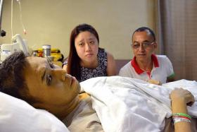 WEAK: Mr Jason Mah struggled to complete his sentences when we met him at the hospital. His wife, Ms Serene Koh, and volunteer Mr Abdul Rahim Osman look on in the background.