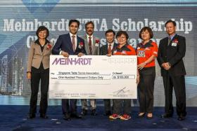 """""""And with this new initiative, I hope that more businesses and corporations will follow Meinhardt's lead and step forward to support our athletes."""" - STTA chief Ellen Lee (third from right) speaking at the 40th anniversary celebration of Meinhardt Singapore."""