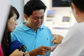 TEARS: After paying $950 for an iPhone 6 for his girlfriend, Vietnamese tourist Pham Van Thoai was made to pay an additional $1,500 by Mobile Air for the phone's warranty. Staff members refused to refund him when he asked, even after he begged them in tears.