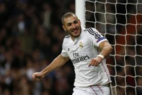 Real Madrid's Karim Benzema celebrates scoring against Liverpool during their Champions League Group B soccer match at Santiago Bernabeu stadium in Madrid November 4, 2014.
