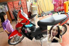 Cheong's youngest daughter looking at her mother's motorcycle.