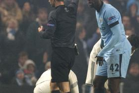 Manchester City's Ivorian midfielder Yaya Toure is sent off during the UEFA Champions League Group E football match between Manchester City and CSKA Moscow at the Etihad Stadium in Manchester Northwest England, on November 5, 2014.