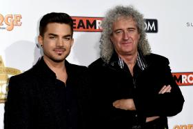 Adam Lambert (left) and Brian May (right) at the 10th annual Classic Rock Roll of Honour awards in Los Angeles, California on Nov 4.