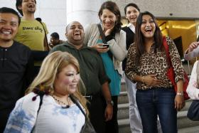 Activists celebrating the overturning of a sharia law against cross-dressing at the Appeals Court in the Palace of Justice in Putrajaya, Kuala Lumpur on Nov 7.