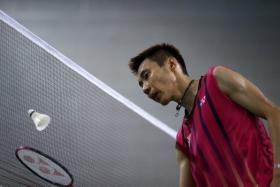 """Malaysian media has reported that Malaysia's Lee Chong Wei's """"B' sample has tested positive for dexamethasone. Here heis pictured at the net during his men's singles semi-final badminton match against China's Lin Dan at Gyeyang Gymnasium at the 17th Asian Games in Incheon in Spetember."""