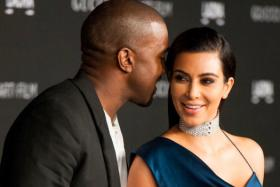 Kim Kardashian and her husband, recording artist Kanye West, arrive for the 2014 LACMA Art + Film Gala honoring film director Quentin Tarantino and artist Barbara Kruger in Los Angeles on Nov 1.