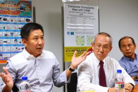 HELP NEEDED: At yesterday's press conference, Sim Lim Square management's chairman Raymond Chua (left), along with the mall's managing agent Chan Kok Hong (middle) and Sim Lim Square management's assistant secretary Sunny Chew (right), appealed for the authorities to be tougher on errant retailers.