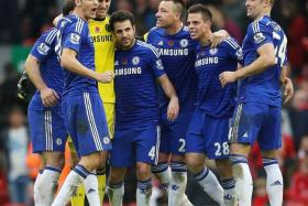BLUE FORCE: Chelsea players celebrating their victory over Liverpool, thanks to the winner from Diego Costa.