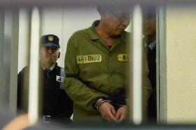 Sewol ferry captain Lee Jun Seok is escorted after arriving at a courthouse in Gwangju on November 11, 2014.