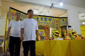 GRIEVING: Madam Ching Guan Eng's sons, Mr Toon Mee Kai (left) and Mr Toon Ngee Suan (right) lived with their mother in her Marsiling flat.