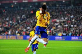 SKIPPER SHOWS THE WAY: Neymar celebrating after scoring against Turkey.