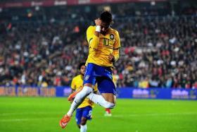 SKIPPER SHOWS THE WAY: Neymar celebrating after scoring against Turkey.