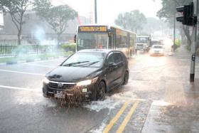 Vehicles moving along the flooded Sembawang Road outside Sembawang Shopping Centre on 7 May 2013. Yesterday, there was mild flooding at the first level of Sembawang Shopping Centre.