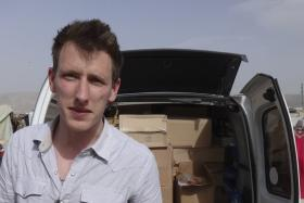 Islamic State militants said in a video November 16, 2014 they had beheaded U.S. hostage aid worker Kassig and warned the United States they would kill other U.S. citizens.