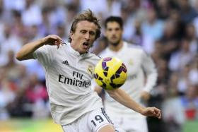 "Real Madrid's Croatian midfielder Luka Modric during the Spanish league ""Clasico"" football match at the Santiago Bernabeu stadium on October 25, 2014."