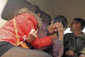 Relatives of the kindergarten children in tears after the incident.