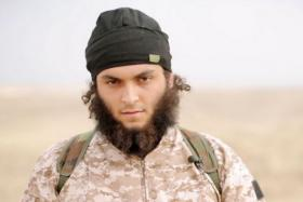 An image grab taken from a propaganda video by al-Furqan Media allegedly shows Mickael Dos Santos, a jihadist believed to be French citizen and member of the Islamic State (IS) jihadist group.