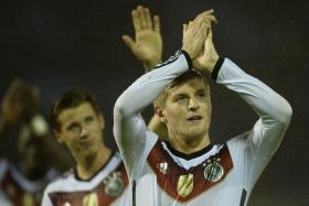 Germany's midfielder Toni Kroos celebrates at the end of the friendly football match Spain vs Germany