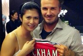THRILLED: Pan Ling Ling, who is a huge fan of David Beckham met him in September (above), then again on Sunday with her family, which includes sons Beckham, Kynaston and husband Huang Shinan.