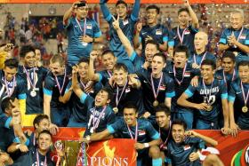 The Singapore national team celebrate their fourth AFF championship win.