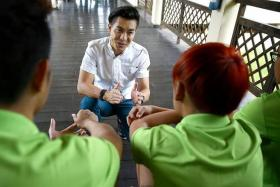 ENCOURAGING: (Above) Actor Pierre Png tells participants that there is a lot of support for them.