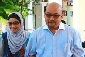 Free to go: Financial adviser Nurulezani  Mat Isa and judge Adam Tumiran leaving the Syariah High Court in Jalan Batu Gantung, Penang, after their acquittal.