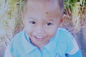 A neighbour eventually led police to the boy's body in a stream.