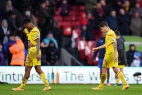 WOEFUL: Liverpool's Raheem Sterling (left) and Philippe Coutinho looking dejected at the end of the match against Crystal Palace.