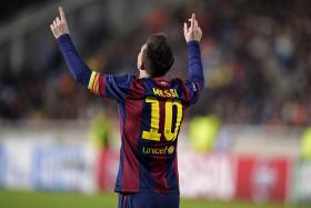 Barcelona's Lionel Messi celebrates after scoring a goal against APOEL Nicosia during their Champions League Group F soccer match in Nicosia on November 25, 2014.