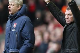 JOB SECURITY: Speculation is rife that Borussia Dortmund's Juergen Klopp is being lined up to miraculously replace both Arsene Wenger (above, left) and Brendan Rodgers (above, right).