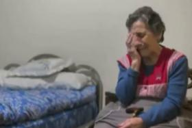 Carmen Martínez Ayudo crying after she was evicted from her home.