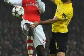 Arsenal's French striker Yaya Sanogo (L) vies with Dortmund's German midfielder Ilkay Guendogan (R) during the UEFA Champions League Group D football match between Arsenal and Borussia Dortmund at the Emirates Stadium in north London.