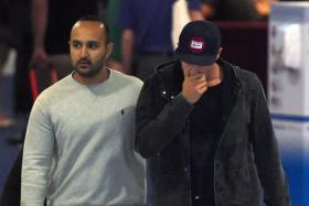 Sean Abbott (R) leaves St Vincent's Hospital following the death of fellow Australian batsman Phillips Hughes in Sydney on Nov 27.