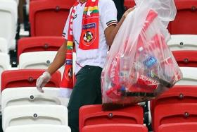 CIVIC-MINDED: Myanmar fans brought their own trash bags to collect the rubbish.