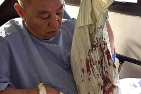 IN PAIN: Cabby Ng Ah Meng showing his bloodied shirt from the day of the attack. He had bled profusely as he is on blood thinners for hypertension.