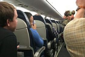 A woman was asked to leave a plane after the pig she was travelling with became disruptive.