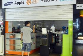 MOVING OUT: Owner of phone shop Mobile Air, Mr Jover Chew, was seen moving merchandise out of his shop in Sim Lim Square (above) into a lorry.