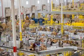 Workers unpack goods at an Amazon Fulfillment Center in Tracy, California, last month.