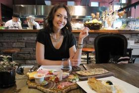 YUMMY: Thai-American culinary TV presenter Angela May enjoying lunch at Bar-Roque Grill at Amara Hotel.