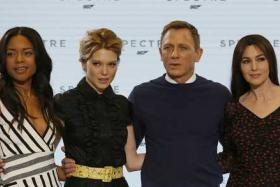 "Actors Naomie Harris, Lea Seydoux, Daniel Craig and Monica Bellucci pose on stage during an event to mark the start of production for the new James Bond film ""Spectre"", at Pinewood Studios."