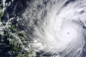 This handout photo released and taken by NASA on December 5, 2014 shows a satellite image of Typhoon Hagupit in the Western Pacific Ocean. Thousands of people in the Philippines sought shelter in churches, schools and other makeshift evacuation centres on December 5 as monster Typhoon Hagupit bore down on the disaster-weary nation.