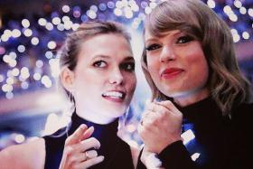 Tweets have popped up online suggesting model Karlie Kloss (left) and pop singer Taylor Swift have moved from being BFFs to being in a relationship with each other.