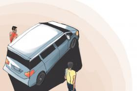 1: While Mr T. H. Tan rests in the back seat of his rented MPV with his toddler, two men get out of a car parked behind the MPV and approach from either sides of the vehicle.
