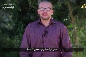 A still video of man, who identified himself as Luke Somers, speaks in this still image taken from video purportedly published by Al Qaeda in the Arabian Peninsula (AQAP).  The video purportedly shows a U.S. hostage and AQAP threatened to kill him if unspecified demands were not met.