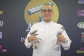 Malaysia rapper SonaOne with his trophies from Anugerah Industri Muzik 2014.
