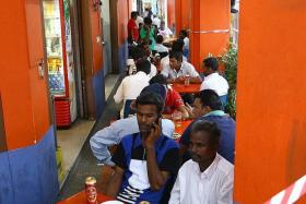 BOUNDARY: Foreign workers having beers at a coffee shop in Little India. Most places serving alcohol have cordons to demarcate their boundaries so customers do not take alcohol out of the area.