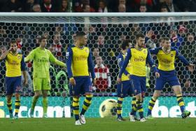 DISARRAY: The Arsenal defenders strike a dejected pose after their 2-3 loss to Stoke last Saturday.