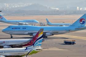 A Korean Air plane sits on the tarmac at Gimpo airport in Seoul on Tuesday.