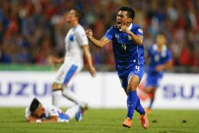 Kroekrit Thawikan celebrates after scoring for Thailand during their Suzuki Cup semi-final against the Philippines.