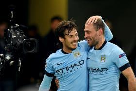 Manchester City midfielder David Silva (L) and defender Pablo Zabaleta celebrate after winning 2-0 against AS Roma.